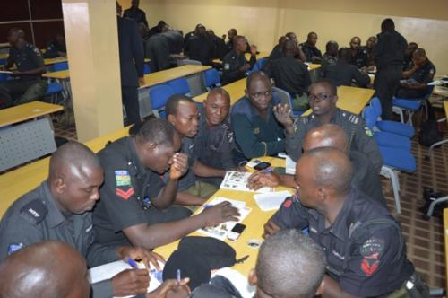Officers working in groups to resolve assigned task