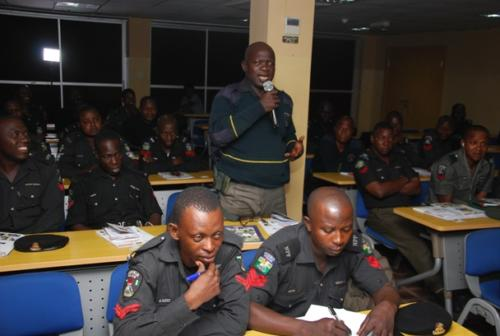 An officer answering a question