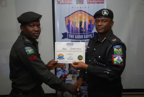 DCP Olatunji Disu presenting certificate to an officer