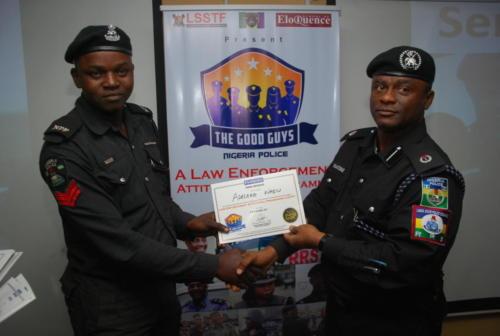 DCP Olatunji Disu presenting certificate to one of the officer