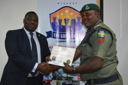 An officer receiving certificate from Mr Lewis of LSSTF