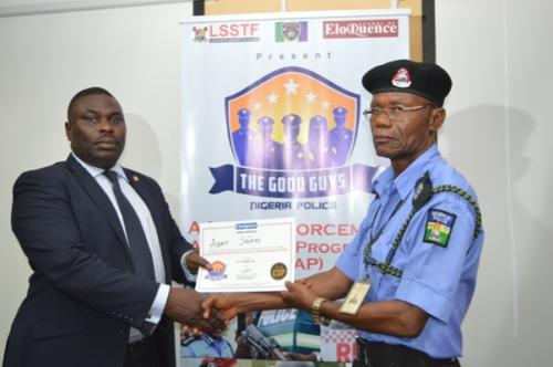 Degbola Lewis presenting certificate to an officer