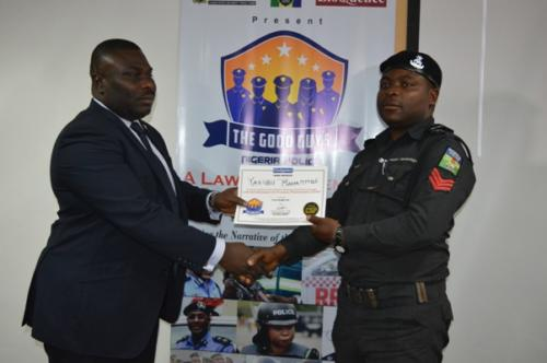 Degbola Lewis presenting certificate to one of the participating officer