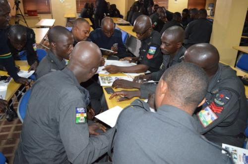 Group of officers consulting over a group task