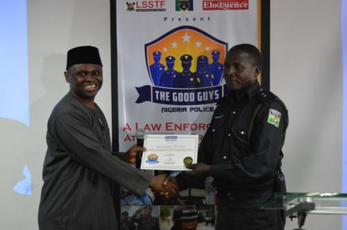 Mister Motivator presenting certificate to one of the officers